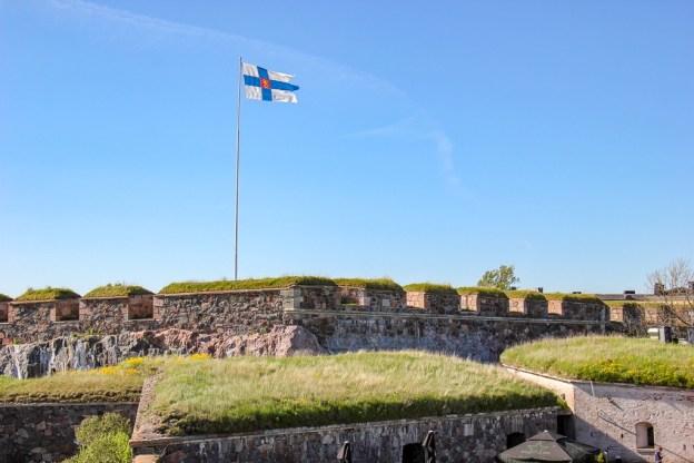 Finland Flag flying at Suomenlinna Fortress in Helsinki, Finland