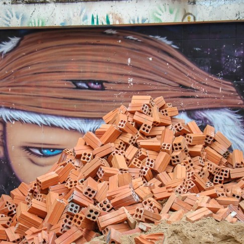 Boy and bricks street art on Street 93 in Phnom Penh, Cambodia