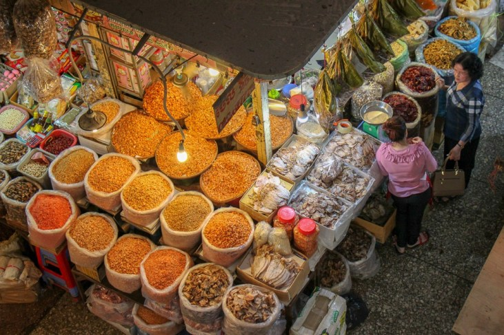 Spices and grains for sale from burlap sacks at Orussey Market in Phnom Penh, Cambodia