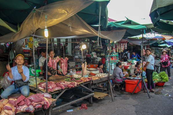 Vendors selling meat at Old Market in Phnom Penh, Cambodia