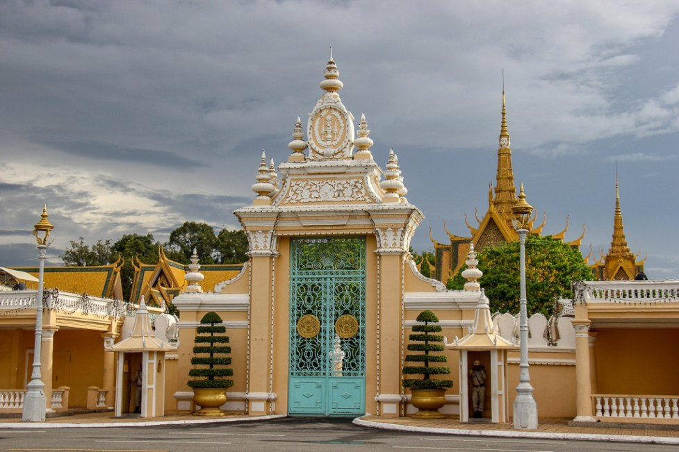 Iron gates and guards at Royal Palace in Phnom Penh, Cambodia