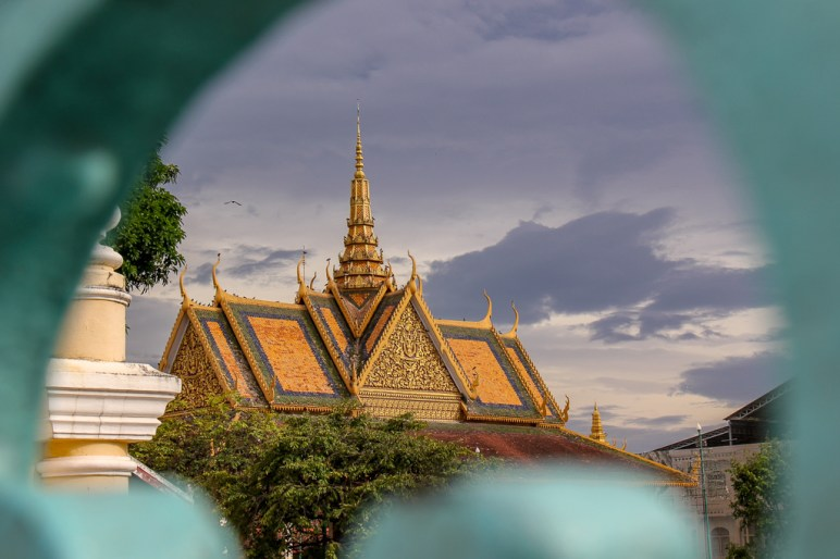 Peeking through the gates of the Royal Palace in Phnom Penh, Cambodia