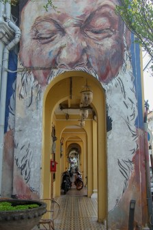 Man's mouth over archway street art in Geroge Town, Penang, Malaysia
