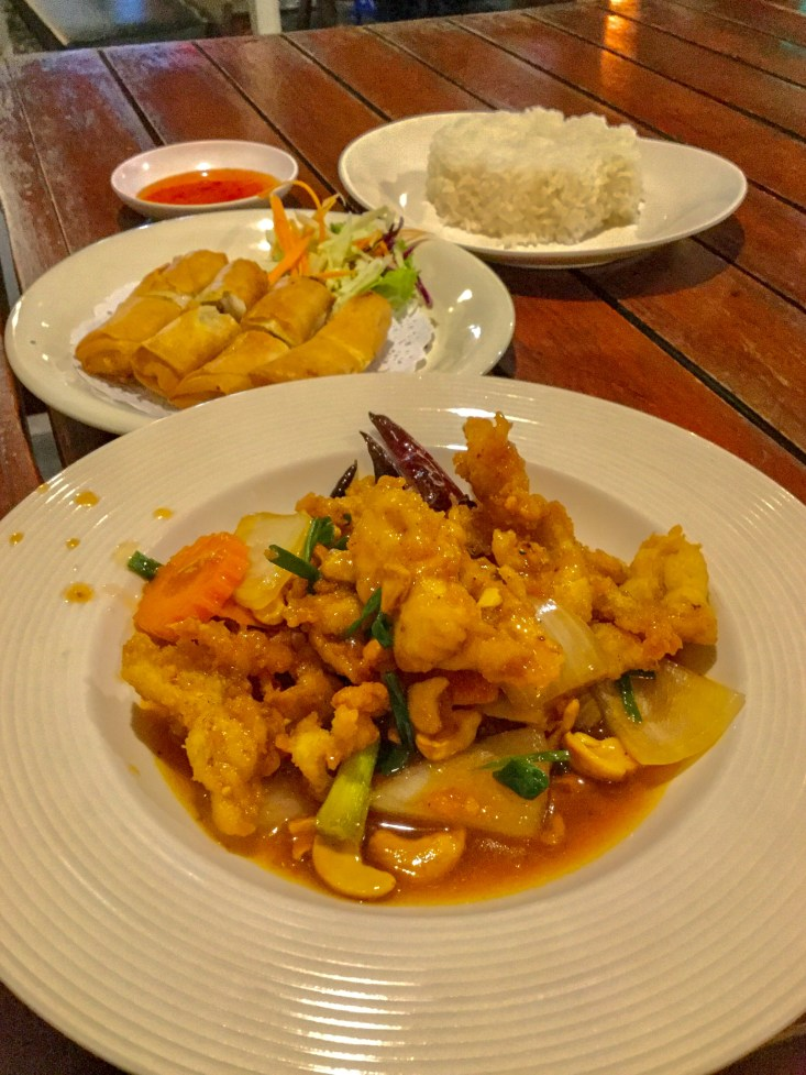 Meal of Cashew Chicken and Duck Spring Rolls at Duck Spicy at Kamala Beach on Phuket, Thailand