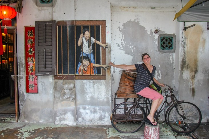 Interacting with street art in Geroge Town, Penang, Malaysia