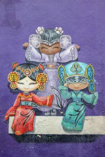 Three smiling girls street art in Geroge Town, Penang, Malaysia