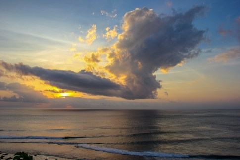 Sunset behind clouds in Uluwatu, Bali, Indonesia