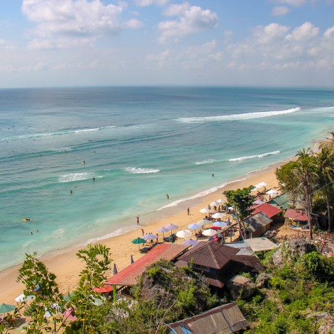 Looking down on Padang-Padang Thomas Beach from staircase in Uluwatu, Bali, Indonesia