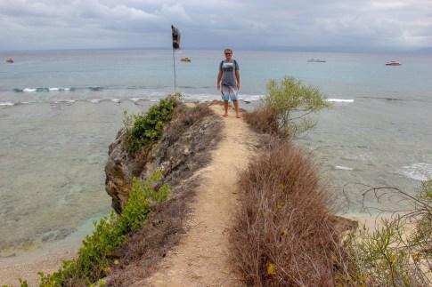 Narrow dirt path to viewpoint over Mushroom Bay on Nusa Lembongan, Bali, Indonesia