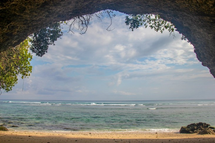 Inside the secret cave on Padang-Padang Thomas Beach in Uluwatu, Bali, Indonesia
