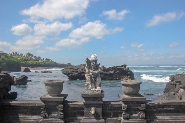 Statue on walkway to Pura Gede Luhur Batu Ngaus Temple in Canggu, Bali, Indonesia