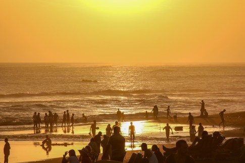 Crowds on Echo Beach at Sunset in Canggu, Bali, Indonesia