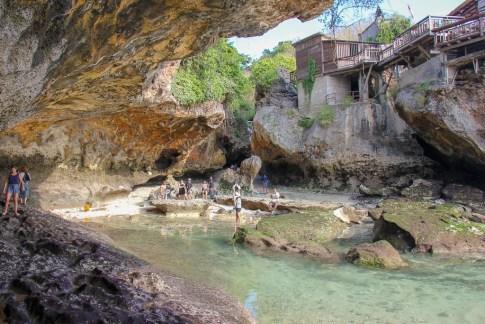 Uluwatu Cave at Suluban Beach in Uluwatu, Bali, Indonesia