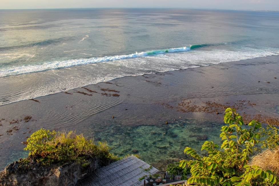 Peering down at the waves in Uluwatu, Bali, Indonesia