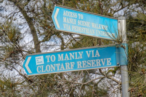 Signs pointing in the direction of Manly to Spit Walk in Sydney, Australia