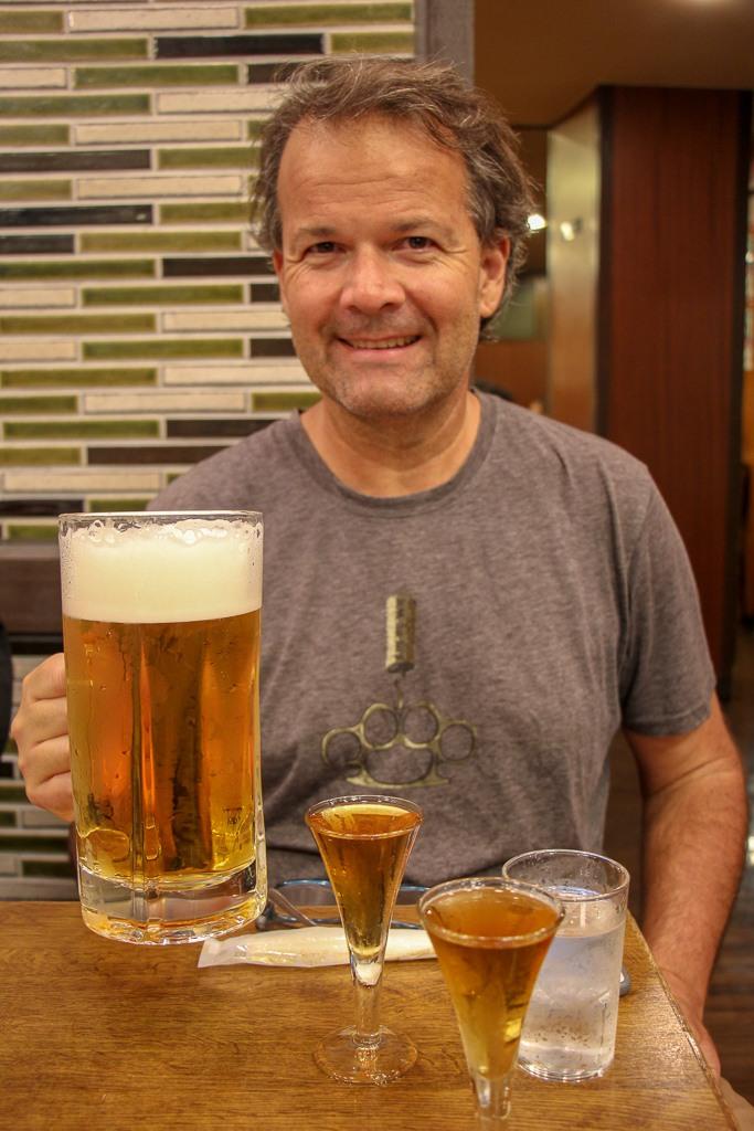 Hoisting liter of beer with Denki Bran in Kamiya Bar in Tokyo, Japan