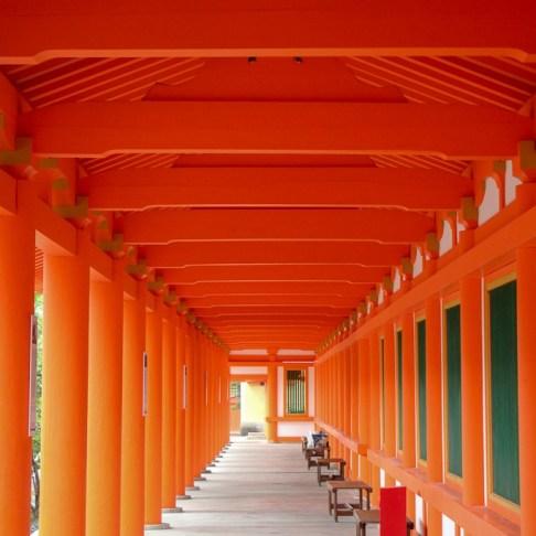 Orange gates over walkwak at Rengeoin Sanjusangendo Temple in Kyoto, Japan