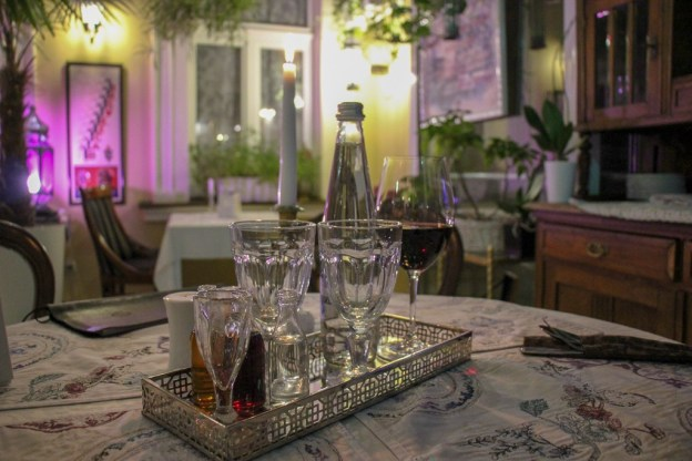 Tray of drinks presented at table at Baczewski Restaurant in Lviv, Ukraine