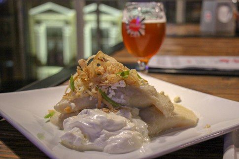 Giant dumplings with sour cream and a beer at Pravda Beer Theater in Lviv, Ukraine