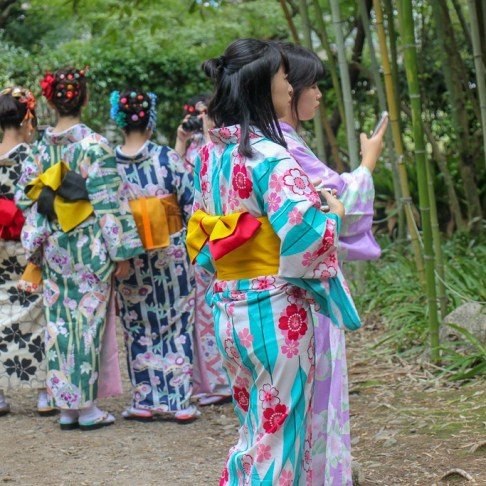 Girls dressed in kimonos at Bamboo Grove in Kyoto, Japan