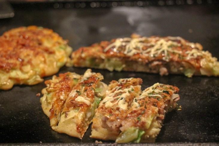 Pieces of cut Okonomiyaki at Sometaro in Tokyo, Japan