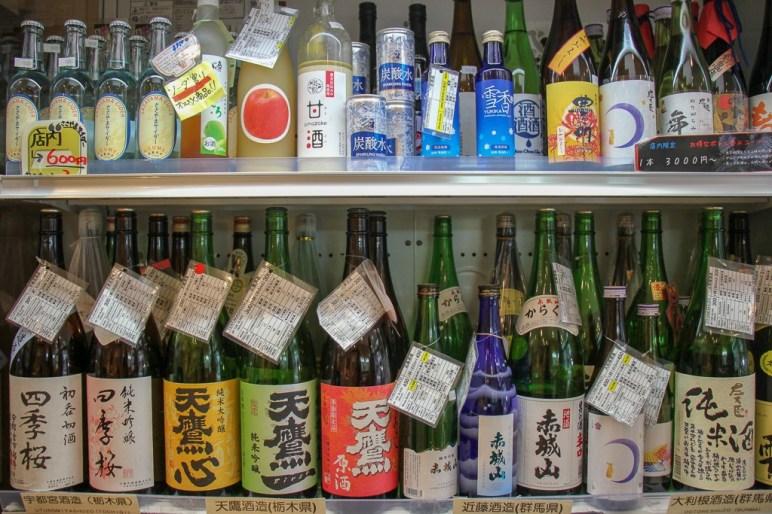 Bottles of chilled sake for sale at Meishu Center in Tokyo, Japan