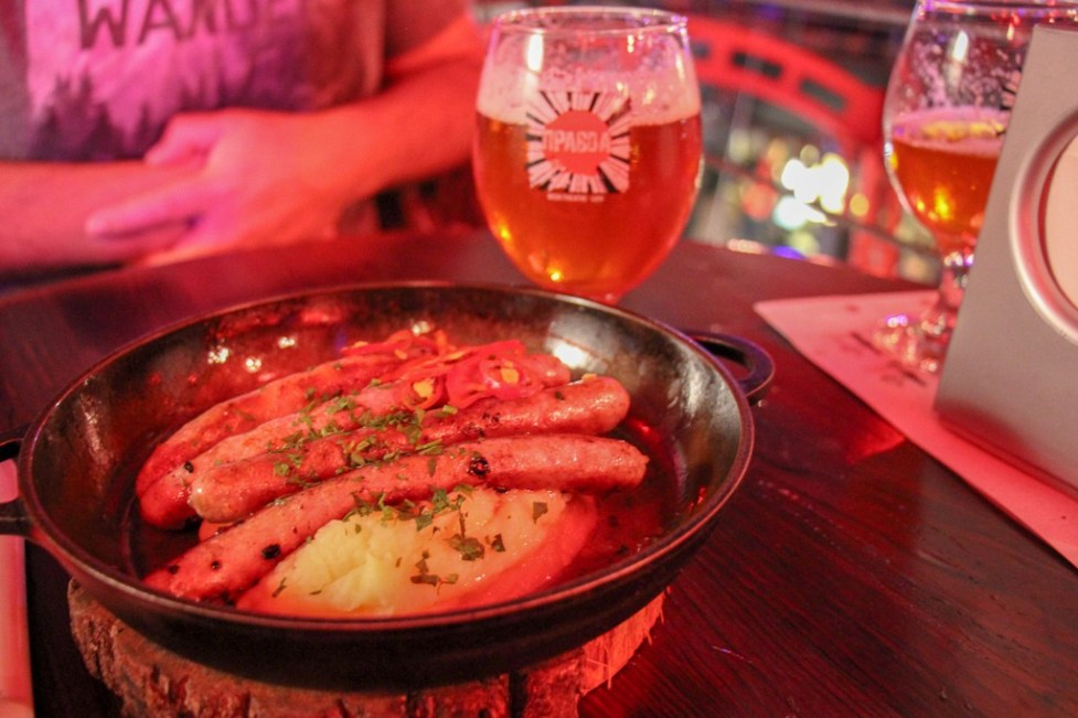 Plate of sausage and mashed potato with beer at Pravda Beer Theater in Lviv, Ukraine