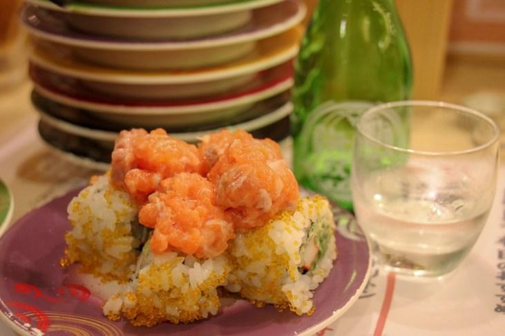 Sushi Roll and Sake at kaiten sushi restaurant Toriton at SkyTree in Tokyo, Japan