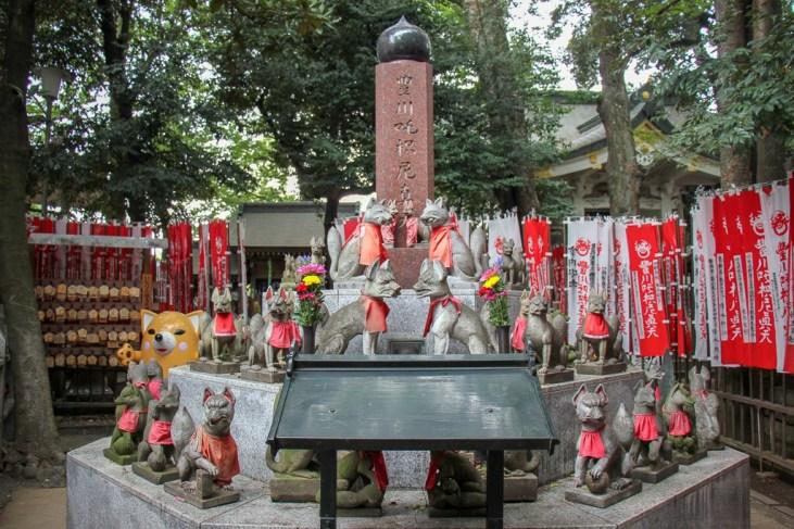 Numerous fox statues at Toyokawa Inari Shrine in Tokyo, Japan