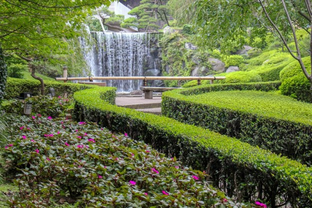 Waterfall at end of path at Hotel New Otani's Garden in Tokyo, Japan