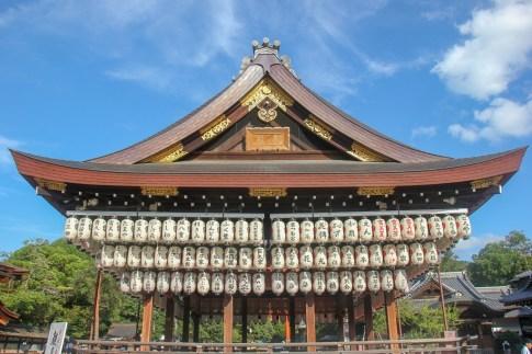 Hanging lanterns on wooden stage at Yasaka Shrine in Kyoto, Japan