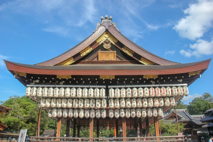Hanging lanterns on wooden stage at Yasaka Shrine in Kyoto, Japan