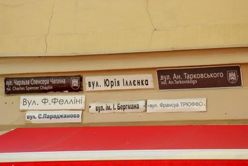 Numerous street signs on Arkihvna Street in Lviv, Ukraine