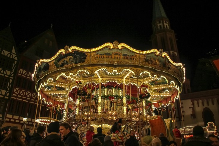 Old-fashioned carousel in Romerberg Square for Christmas Market in Frankfurt, Germany