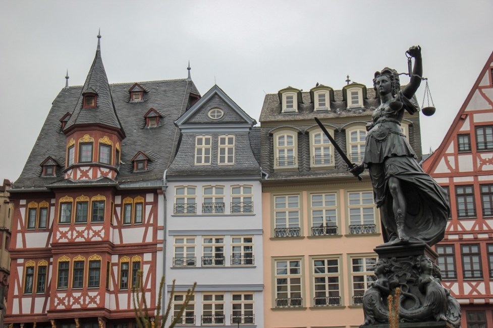 Fountain of Justice and half-timbered houses on Romerberg Square in Frankfurt, Germany