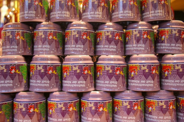 Stacked Gluhwein mugs at vendor stall at Christmas Market in Frankfurt, Germany