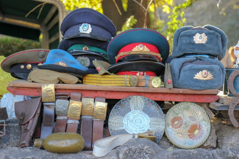Military hats and antiques for sale at Book Market in Lviv, Ukraine