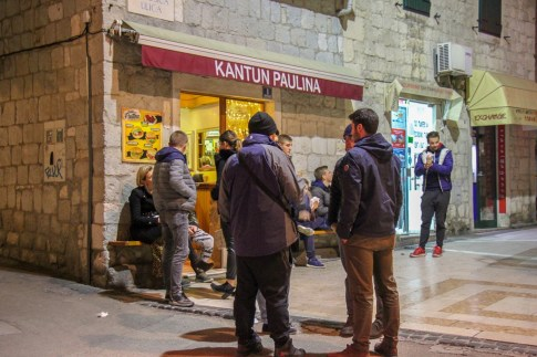 People hanging out at Kantun Paulina cevapi shop in Split, Croatia