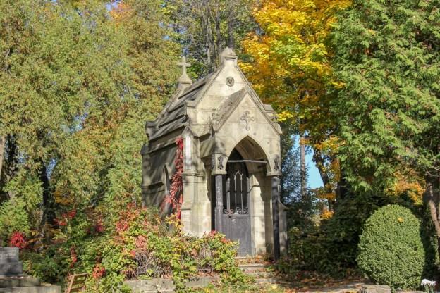 Stone mausoleum in a forest at Lychakiv Cemetery in Lviv, Ukraine