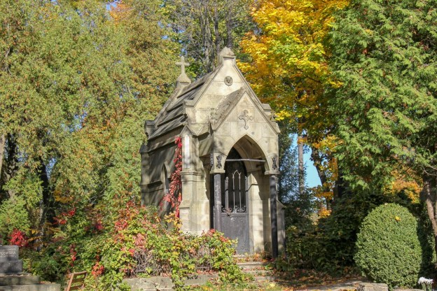 Stone mausoleum in a forest at Lychakiv Cemetery in Lviv, Ukraine