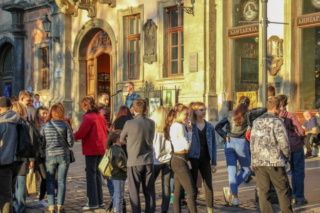 People gather in Rynok Square in Old Town Lviv, Ukraine