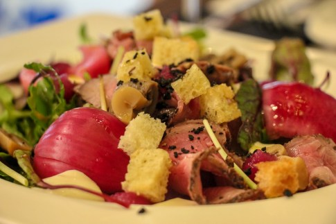 Roast Beef Salad with onion, croutons and suace at Articok Restaurant in Split, Croatia