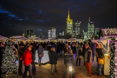 Rooftop Christmas Market with city skyline views in Frankfurt, Germany