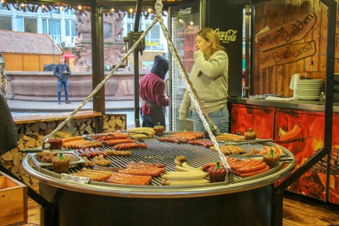 Sausages on giant grill at Frankfurt Christmas Market in Frankfurt, Germany