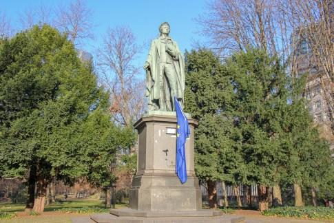 Statue of German poet, Schiller, in greenbelt park in Frankfurt, Germany