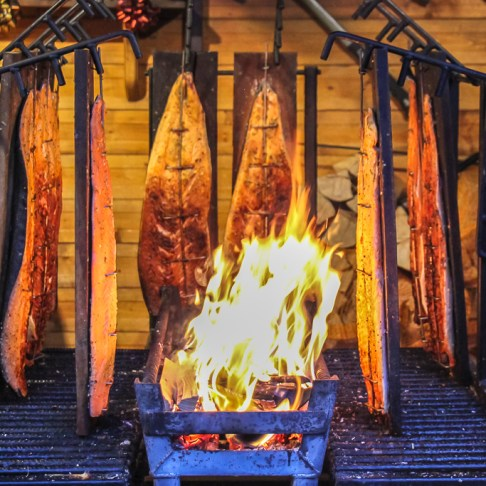 Fire-smoked fish at Christmas Market in Frankfurt, Germany