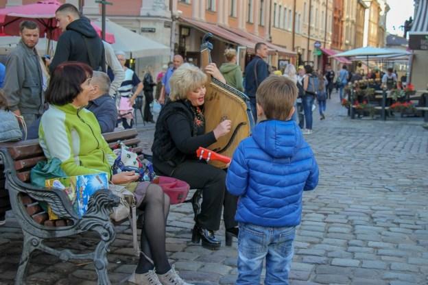 Boy watches street musicians in Rynok Square in Lviv, Ukraine