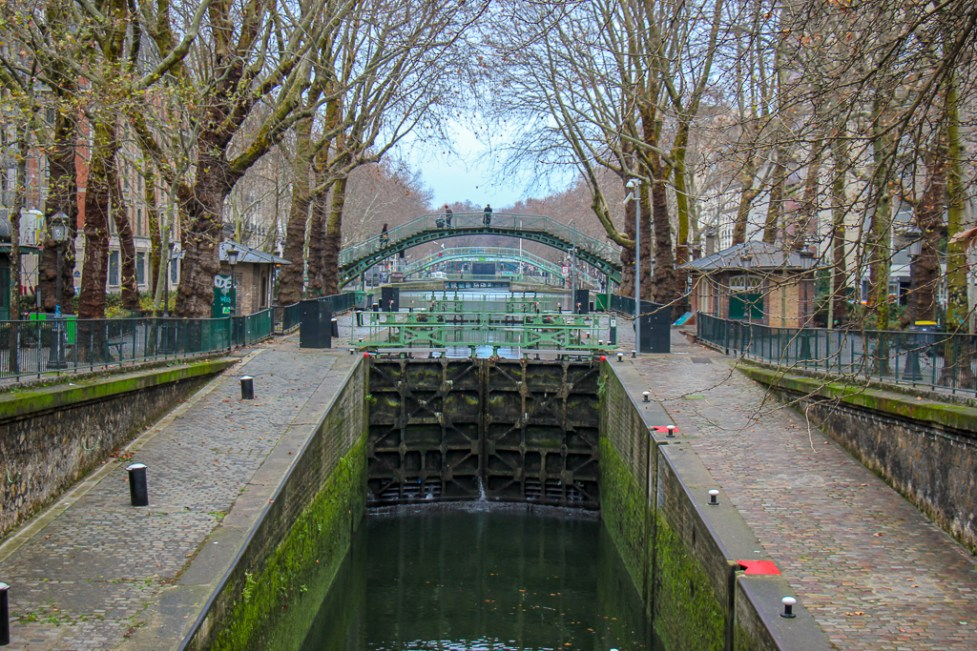 Iron bridge and lock on Canal Saint Martin in Paris, France