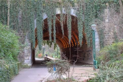 Vine-covered tunnel on Coulee Verte Rene Dumont park in Paris, France