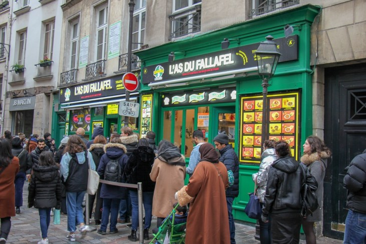 Line for falafel sandwiches at L'as du Fallefel in La Marais District in Paris, France